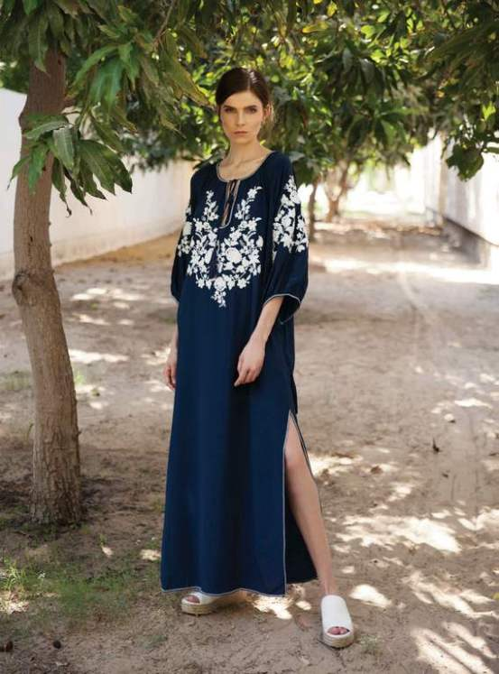 KAFTAN: P.A.R.O.S.H. Al Ostoura The Avenues, Designers by Al Ostoura Zahra Complex. SHOES: Vince Al Ostoura Thuraya Mall, Al Ostoura The Avenues.