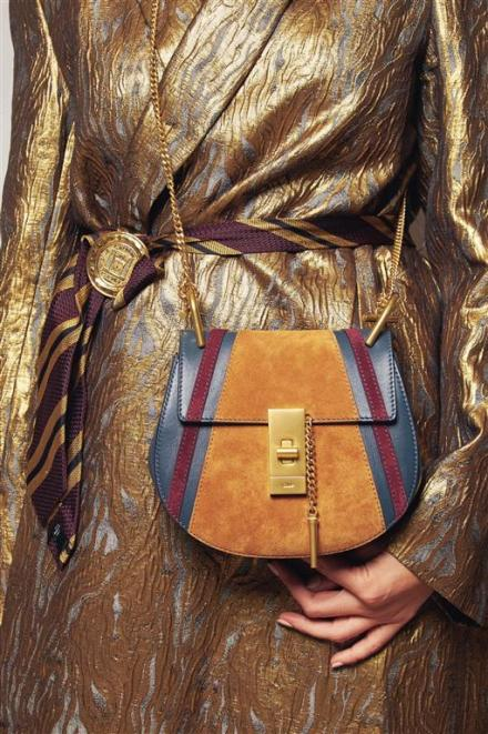 Coat: Dries Van Noten Brooch: What Goes Around Comes Around Bag: Chloé
