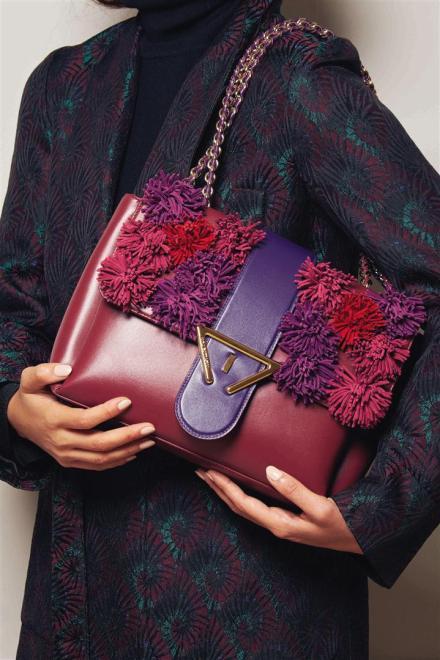 Coat: Dries Van Noten Bag: Sara Battaglia