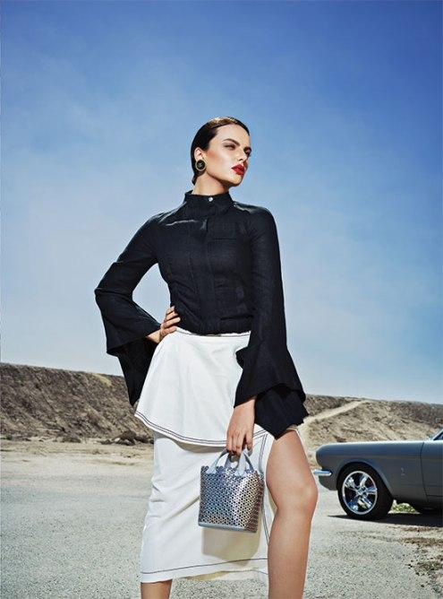 TOP: Loewe - Al Ostoura Thuraya Mall, Al Ostoura The Avenues SKIRT: Stella McCartney - Thuraya Mall, Al Ostoura Salhiya Complex BAG: Alaïa - Thuraya Mall EARRINGS: Vintage Chanel - What Goes Around Comes Around Thuraya Mall