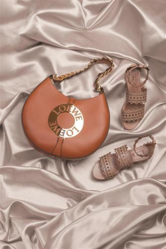 Bag: Loewe / Al Ostoura Thuraya Mall, Al Ostoura The Avenues Shoes: Delpozo / Al Ostoura Thuraya Mall