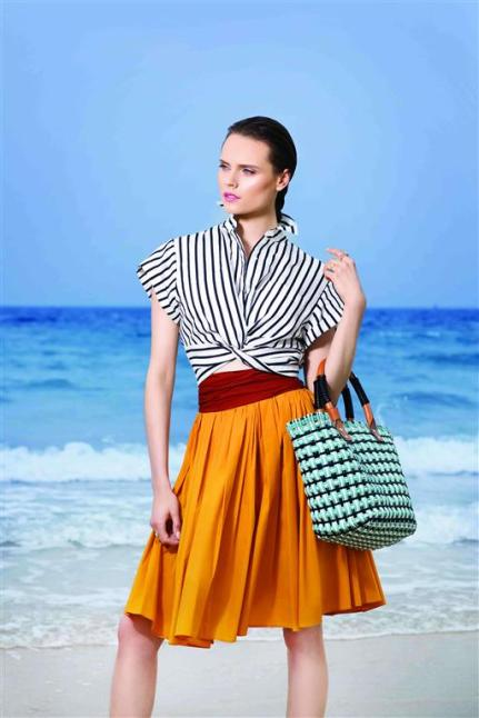 SHIRT: T By Alexander Wang - Al Ostoura Mezzanine Thuraya Mall, Al Ostoura The Avenues BAG: Balenciaga - Thuraya Mall, Al Ostoura Salhiya Complex SKIRT: Paule Ka - Al Ostoura The Avenues, Al Ostoura The Gate Mall