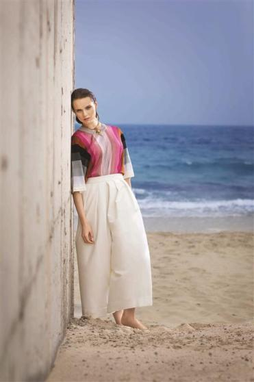 TOP: Marco De Vincenzo - Al Ostoura Thuraya Mall TROUSERS: Delpozo - Al Ostoura Thuraya Mall NECKLACE: Marni - Thuraya Mall